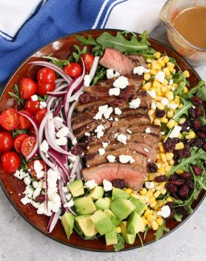 Steak Salad is a hearty and incredibly delicious meal for lunch or dinner. A flavorful steak salad recipe combines perfectly pan-seared juicy steak with fresh vegetables and balsamic vinaigrette dressing.