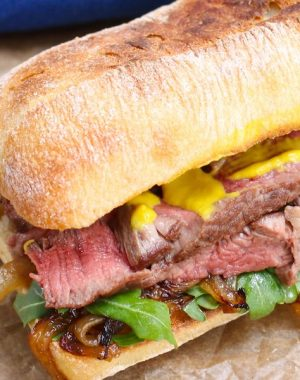 Steak Sandwich is a hearty and flavorful sandwich loaded with tender and thinly-sliced steak, green vegetables, caramelized onions and mustard, along with the delicious toasted buns.