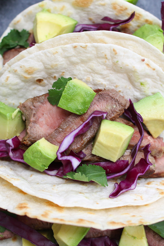 A simple steak taco made with steak, tortilla and a few toppings without cheese