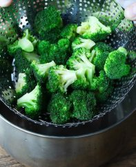 The secret to the perfectly cooked broccoli with vibrant green color is the proper broccoli steam time. It's best to steam fresh broccoli for about 5-7 minutes on the steamy water