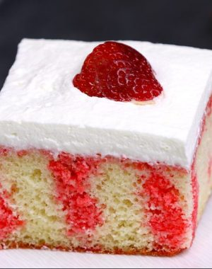 Strawberry Jello Poke Cake is a traditional southern dessert featuring a cake layer imbued with strawberry jello, a creamy topping and fresh strawberries on top