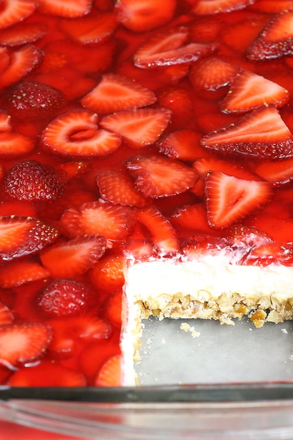 This Strawberry Pretzel Salad has mouthwatering layers of crushed pretzels and cheesecake topped with sliced strawberries in jello. It's the perfect dessert you can make ahead of time for a party or holiday with friends and family.