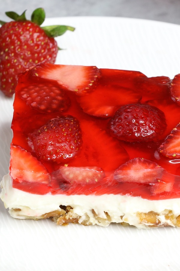 Strawberry pretzel salad is a 3-layer dessert consisting of a strawberry jello topping, a cheesecake filling and a caramelized pretzel crust. It's often called strawberry pretzel dessert or simply jello pretzel dessert.