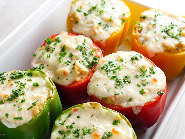 Stuffed Bell Peppers make a colorful side dish for a holiday feast or any lunch or dinner - these ones are made with Creamy Chicken Noodle soup mixed with breadcrumbs and parmesan for a delicious filling