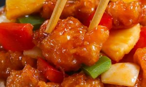 Sweet and Sour Chickenhas the most delicious crispy chicken with chunks of onion, bell pepper and pineapple in a homemade sweet and sour sauce.