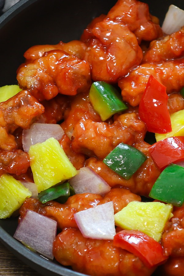 This homemade Sweet and Sour Pork with onions, belle peppers and pineapple is mouthwateringly delicious, better than Chinese takeout