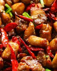 This Szechuan Chicken is the classic Chinese dish made with chicken thighs, Szechuan peppercorns, dried chilis, garlic, ginger and green onions. It makes a fabulous dinner idea for anyone who loves spicy food!
