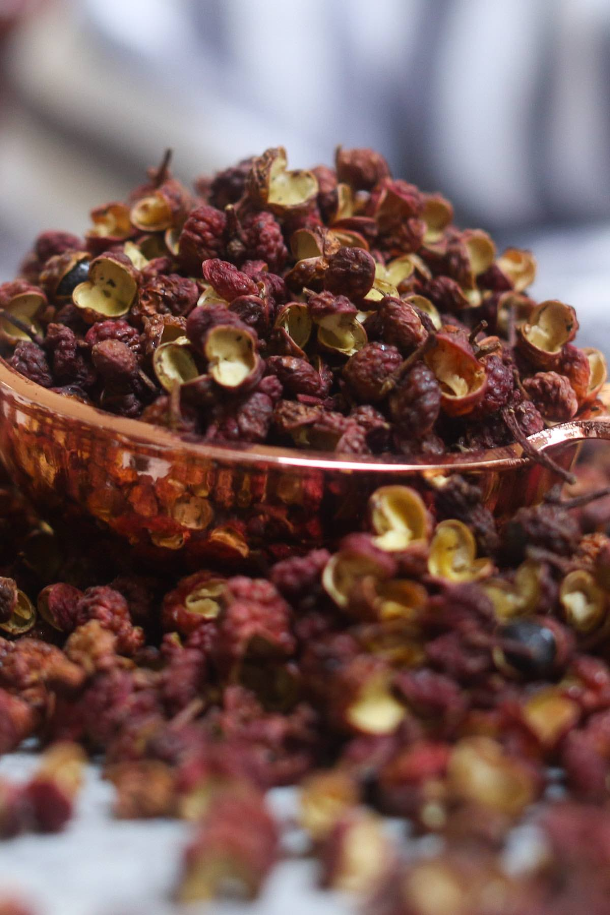 Szechuan peppercorn is a spice produced from the pinkish-red husks of seeds of the prickly ash tree (Zanthoxylum).