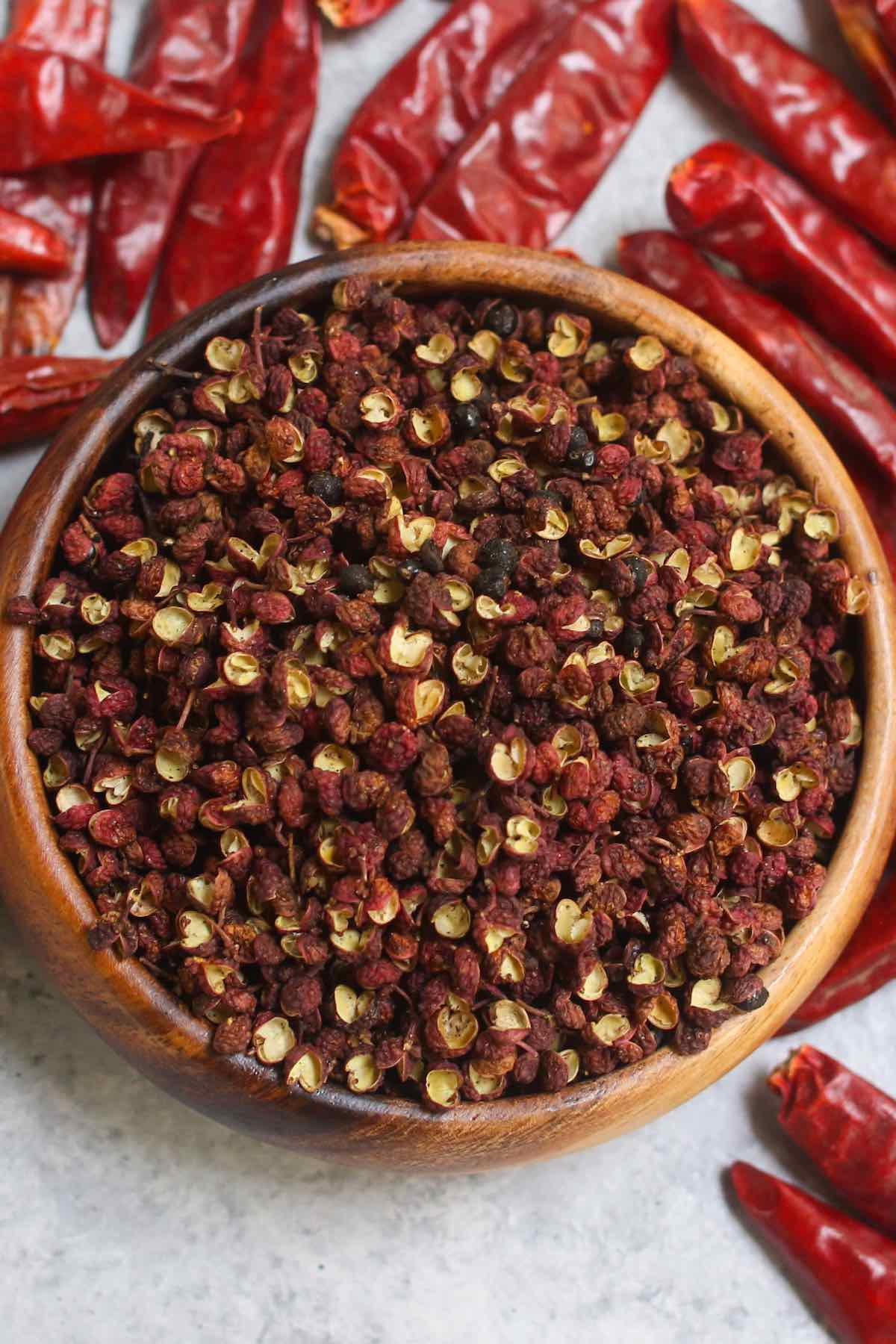 Szechuan peppercorns in a wooden bowl.