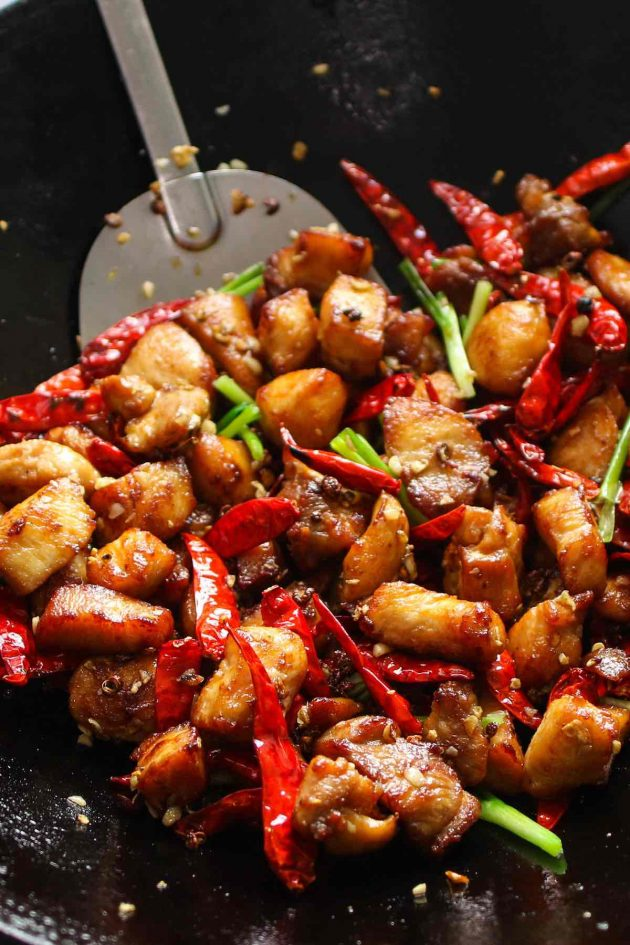 Cooked Szechuan chicken in a wok.
