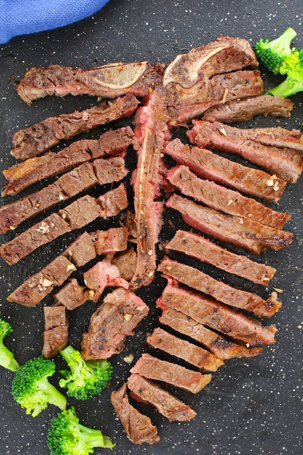Cut cooked T-bone steak from the bone and slice the steak cross the grain