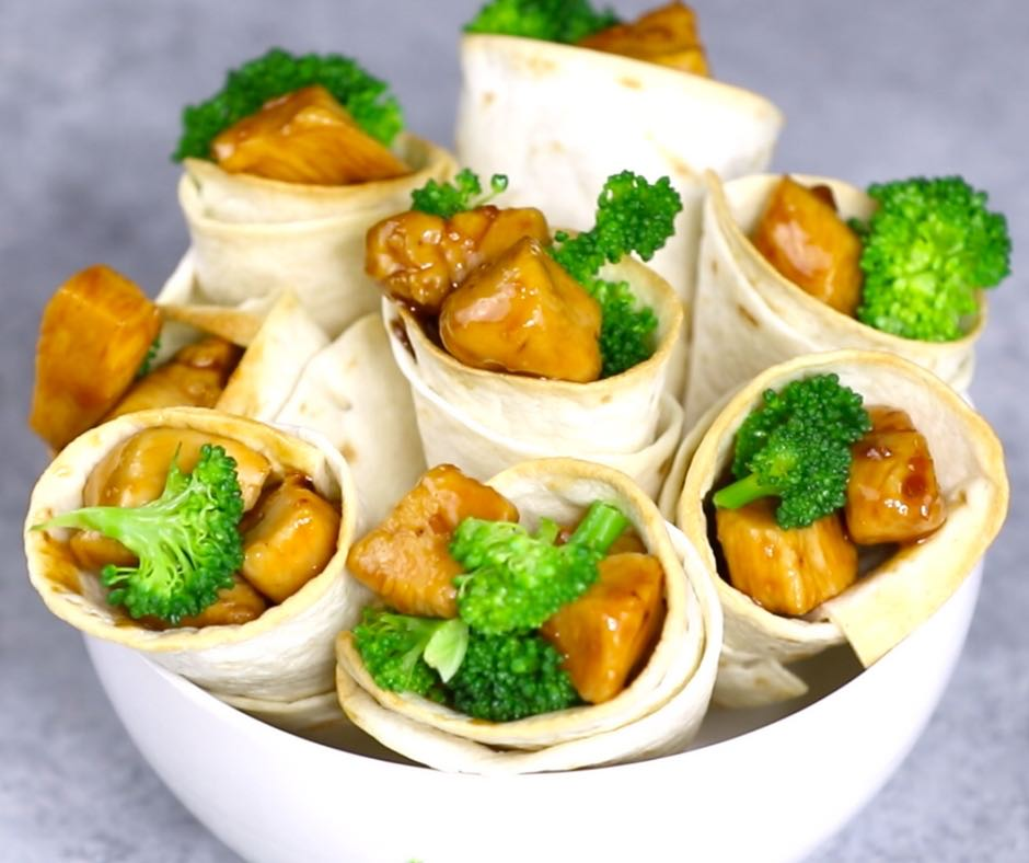 Teriyaki chicken and broccoli wrapped in a flour tortilla