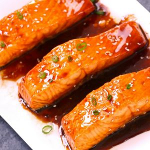 This Teriyaki Salmon is flaky, juicy and pan-fried to perfection with homemade Teriyaki Sauce. It's the easiest, most flavorful teriyaki salmon you'll ever eat. A healthy weeknight dinner option that's ready in 20 minutes. Plus video recipe!