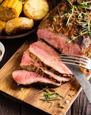 Slices of top round roast beef on a carving board