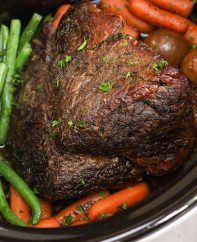 London broil with carrots, potatoes and green beans in the crock pot