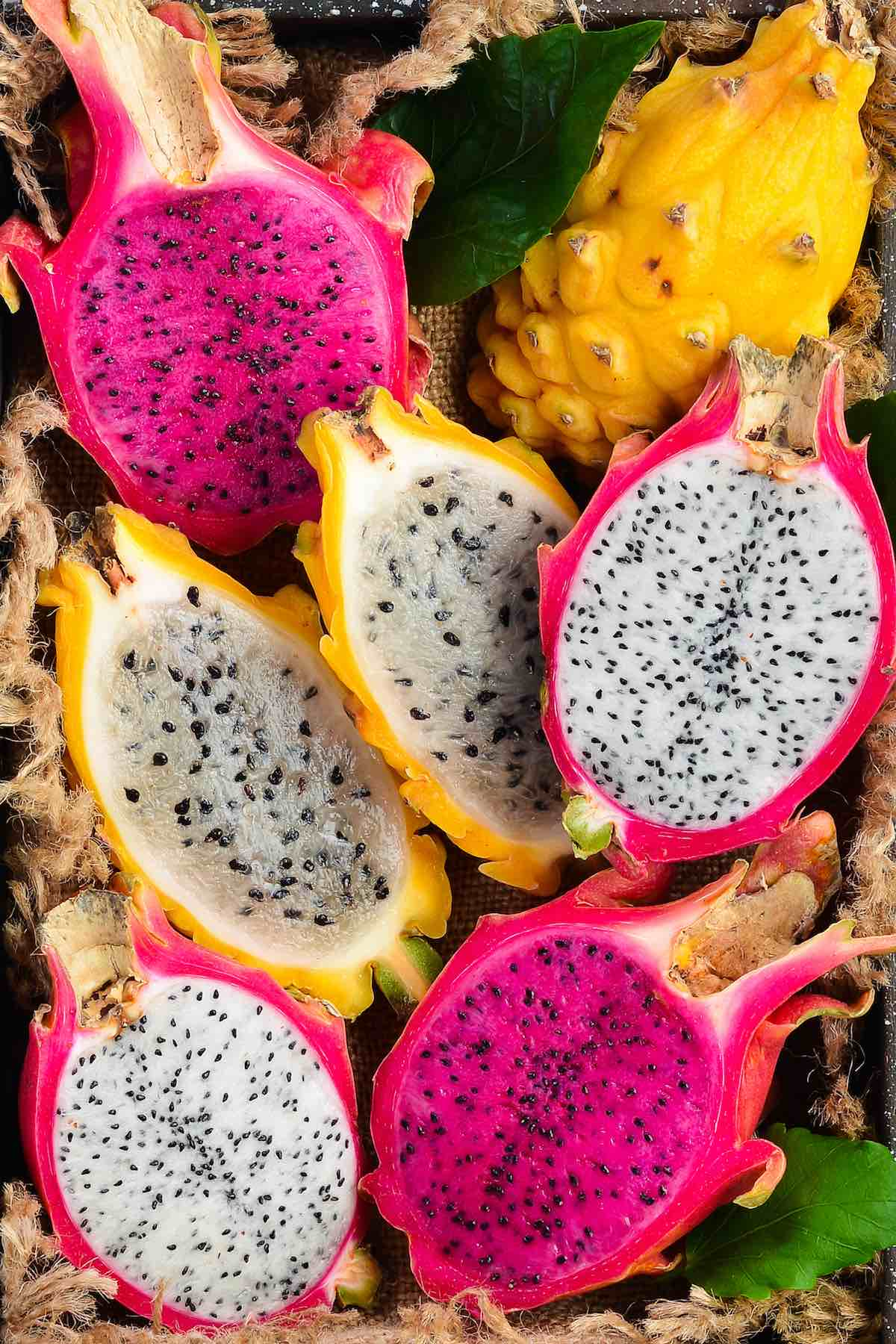 Side-by-side comparison of red, white and yellow dragon fruit showing the different colors and textures of the flesh