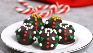 Ugly Christmas Sweater Oreo Truffles are an adorable holiday treat or gift idea made with oreo cookies, cream cheese and semisweet chocolate for delicious bites of awesomeness