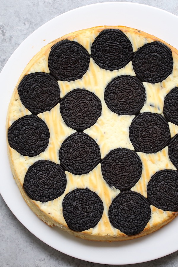 Upside Down Oreo Cheesecake is a simple 6 ingredient dessert made with cream cheese, eggs, yogurt, vanilla and whole oreo cookies on the bottom for a stunning presentation that's perfect for a party