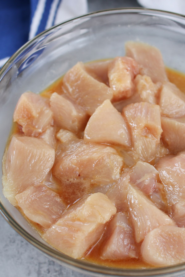 Velveting Chicken is a Chinese secret to the tender and juicy texture of a chicken stir-fry. Learn how to velvet chicken and understand the process of how to make the melt-in-your-mouth meat at home from scratch