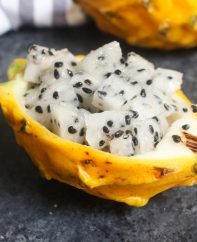 Yellow dragon fruit flesh cut into chunks and served in the skin