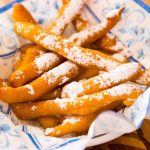 Easy Funnel Cake Fries – delicious cake batter is fried to perfect golden crispy fries. Served with some caramel sauce or a marshmallow dip! You can make the cake batter following our tutorial or get a funnel cake mix from your grocery store. So yummy! Great for snack, parties, or dessert! Quick and easy recipe. Video recipe.   Tipbuzz.com